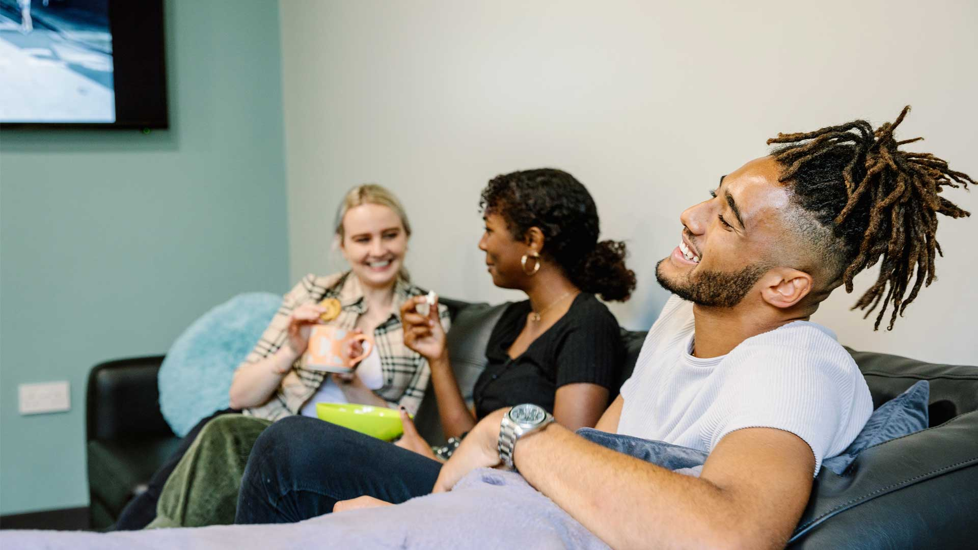 Students relaxing in a lounge at Storthes Hall