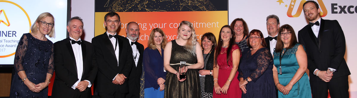 Huddersfield staff collecting the Global Teaching award on the night