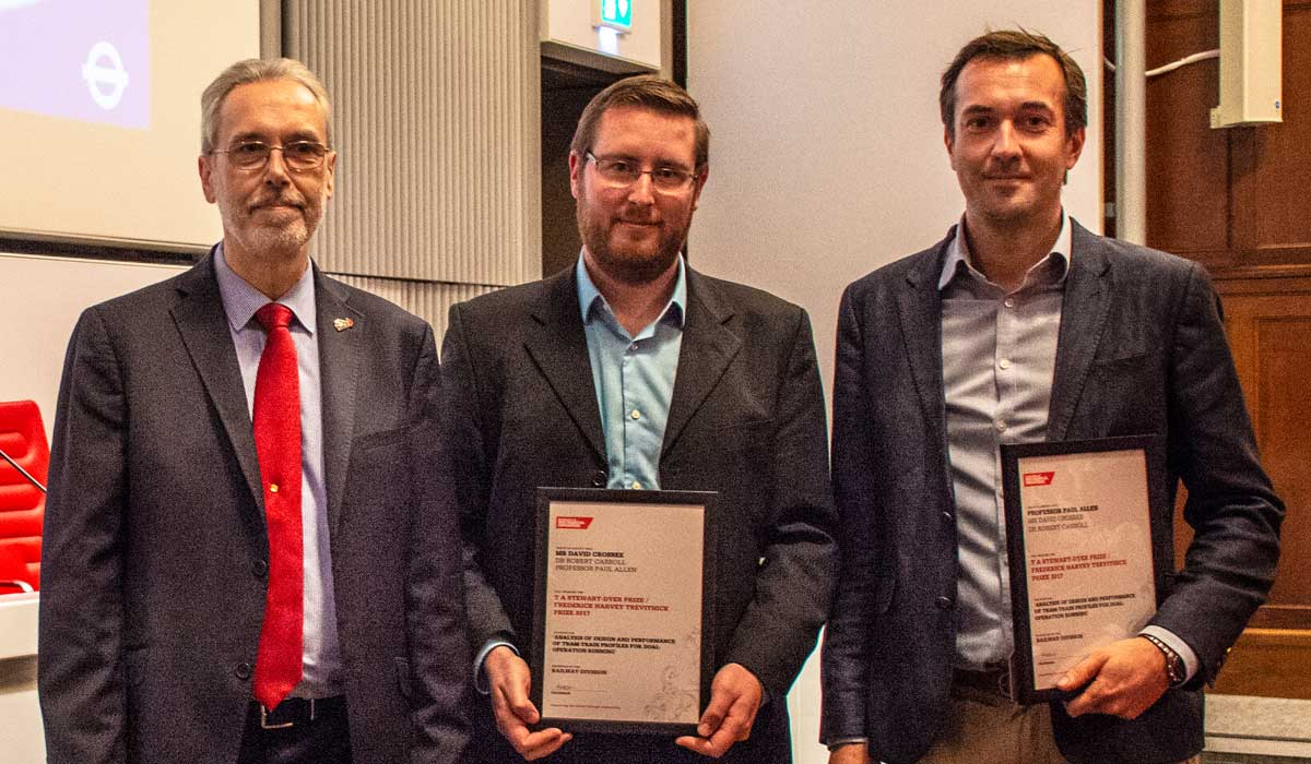 Pictured receiving their award David Crosbee (centre) and Professor Paul Allen (right)