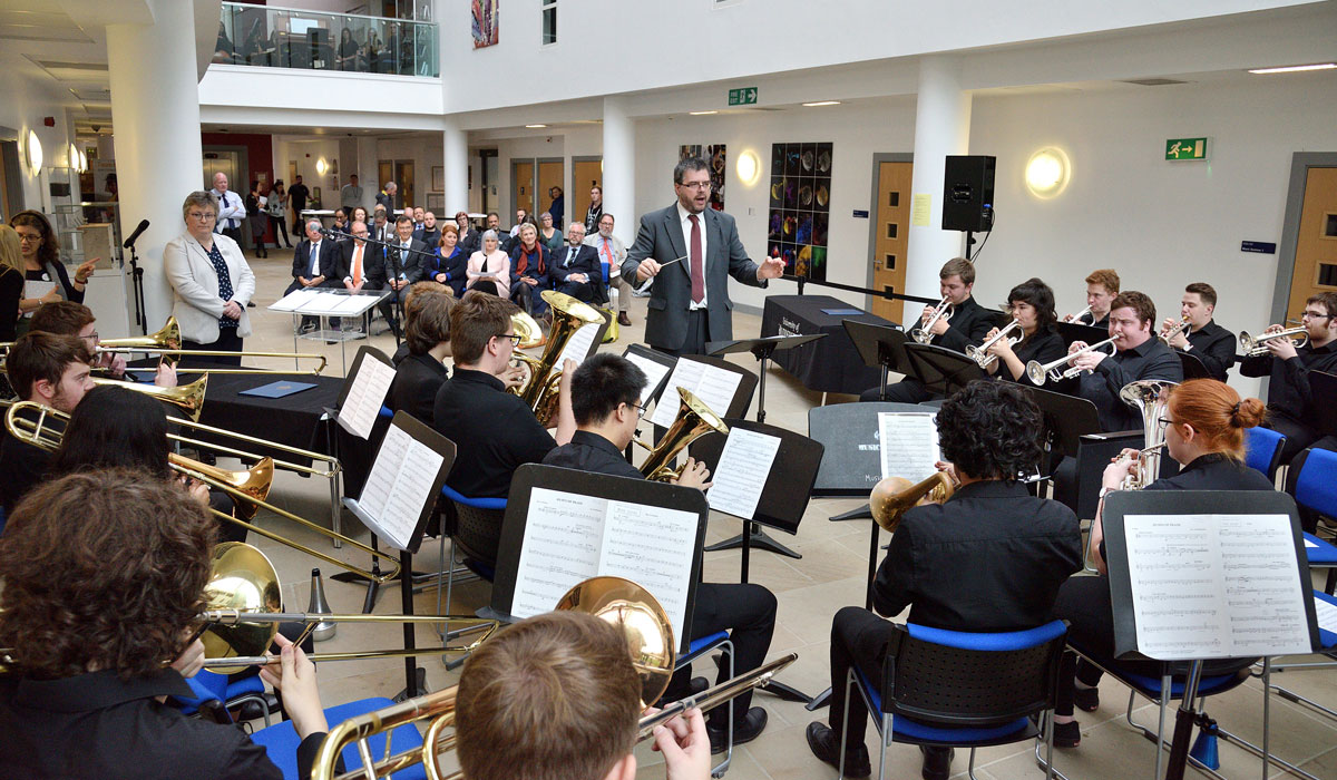 The University's Brass Band play at the signing ceremony