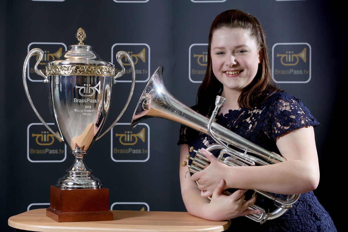 Tenor horn player Siobhan Bates with the cup for winning the BrassPass.tv Young Brass Award 2019