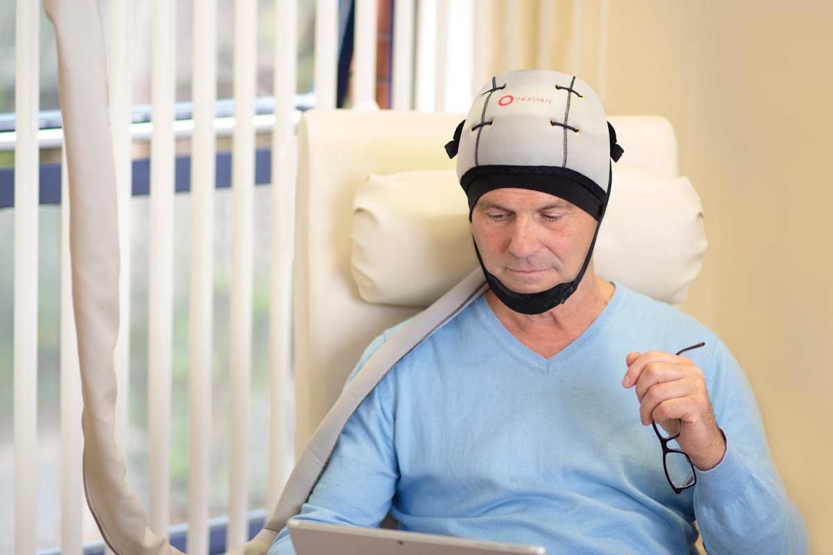 patient wearing a paxman cooling cap