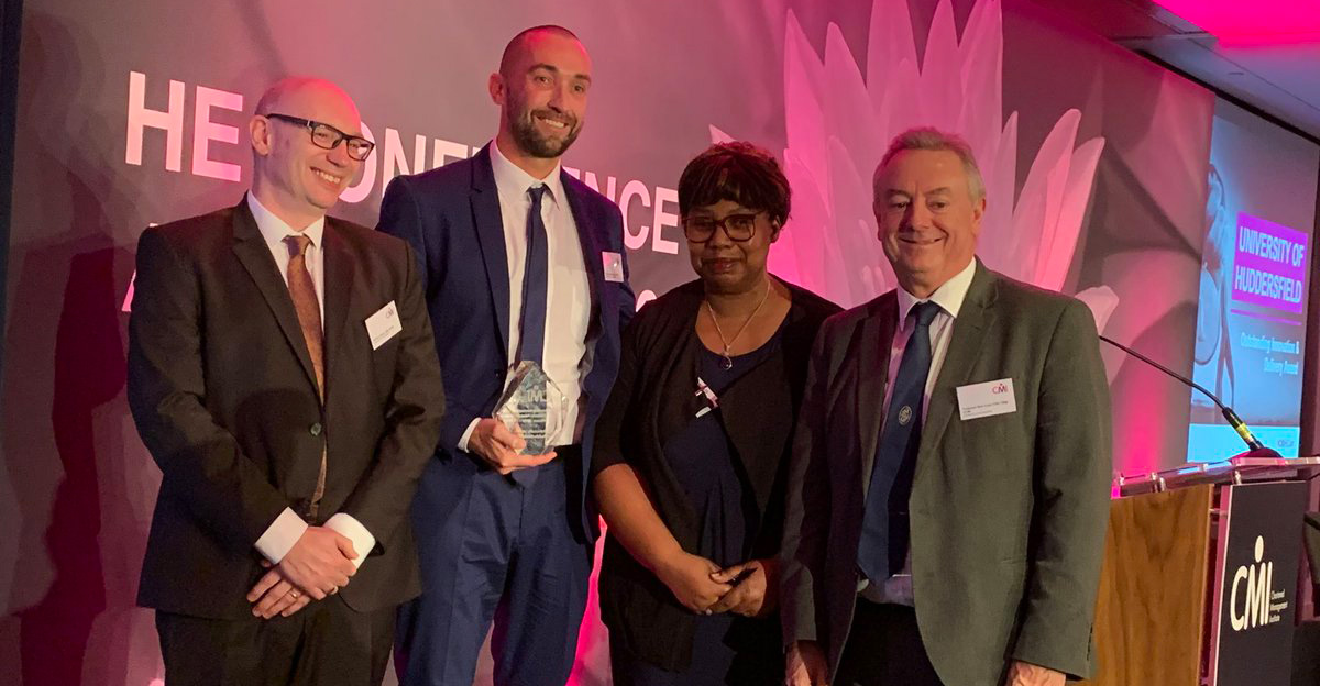 Pictured receiving the award for the University at the ceremony are Head of Staff Development Danny Benton (second left) and Professor Bob Cryan (right).