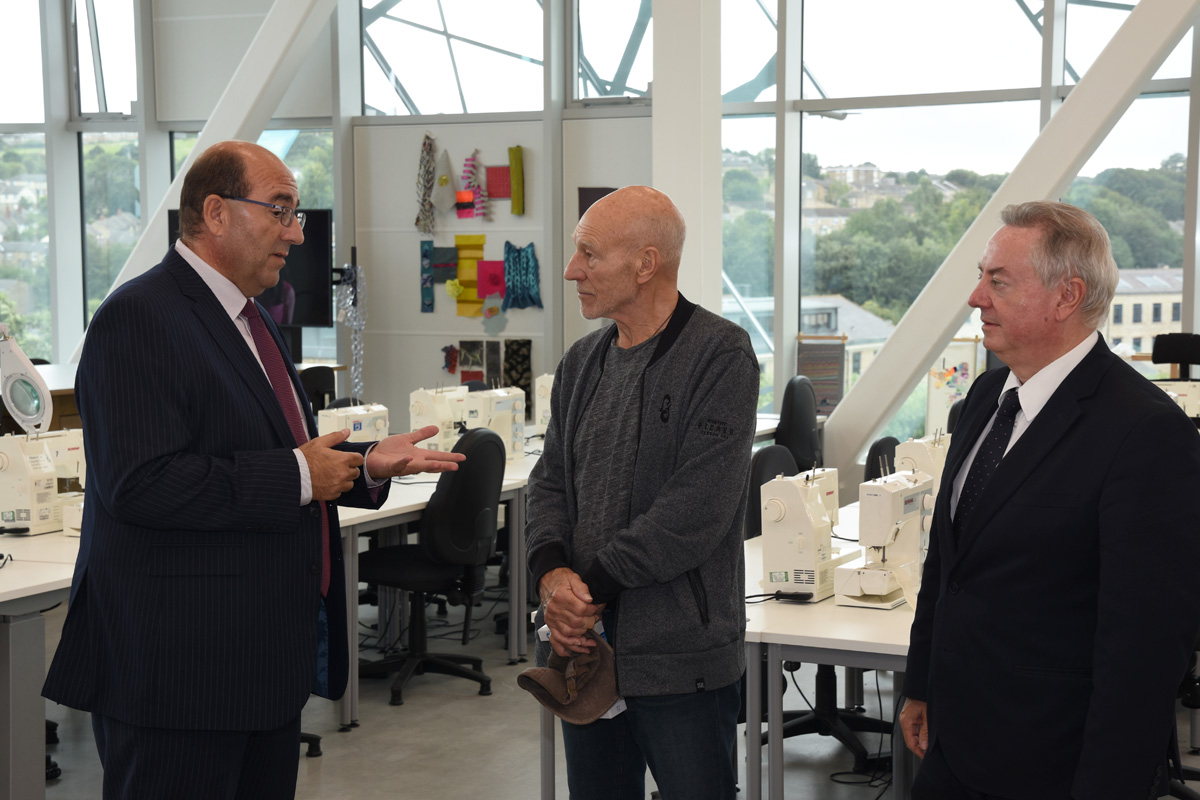 Sir Patrick Stewart (centre) with Professor Mike Kagioglou (left) in the new Barbara Hepworth Building at the University of Huddersfield