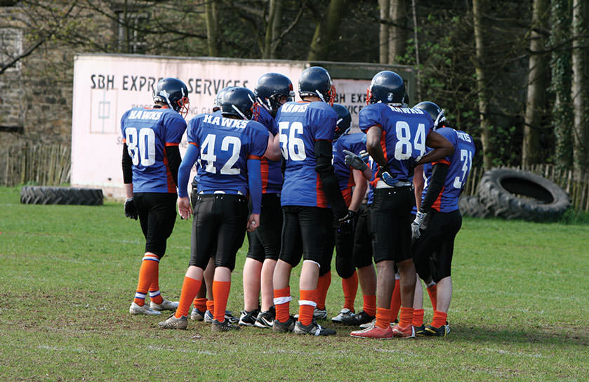 The University runs a variety of clubs and societies. Pictured is the University's American Football team, the Huddersfield Hawks in a huddle