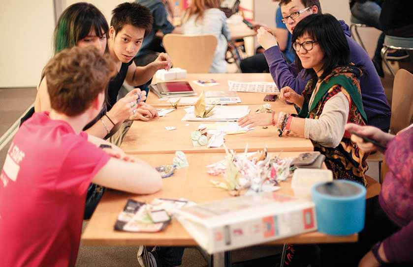The STARS studen recognition programme helps students to become more employable. Pictured is a group of students in the STARS scheme working on a project around a table.